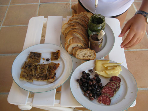 Our first market meal: pissaladiere, saucisson, olives, cheese, tapenade, and pistou